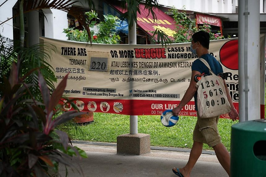 A banner in Sims Avenue last week showing the number of dengue cases in the area. There are over 370 active dengue clusters in Singapore, mostly in the east, with 133 considered high-risk. The biggest cluster is in the Bukit Panjang-Woodlands area, w