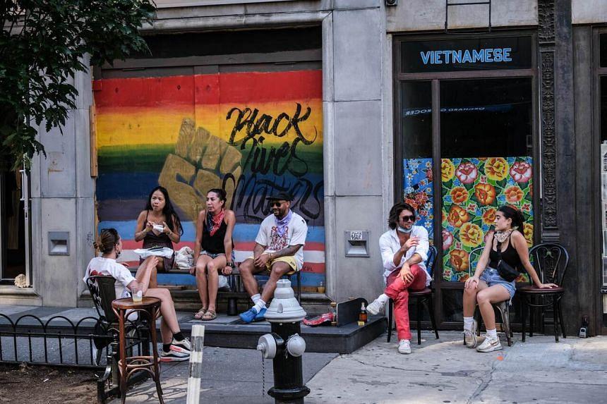 People dine al fresco in Manhattan on July 4, 2020.