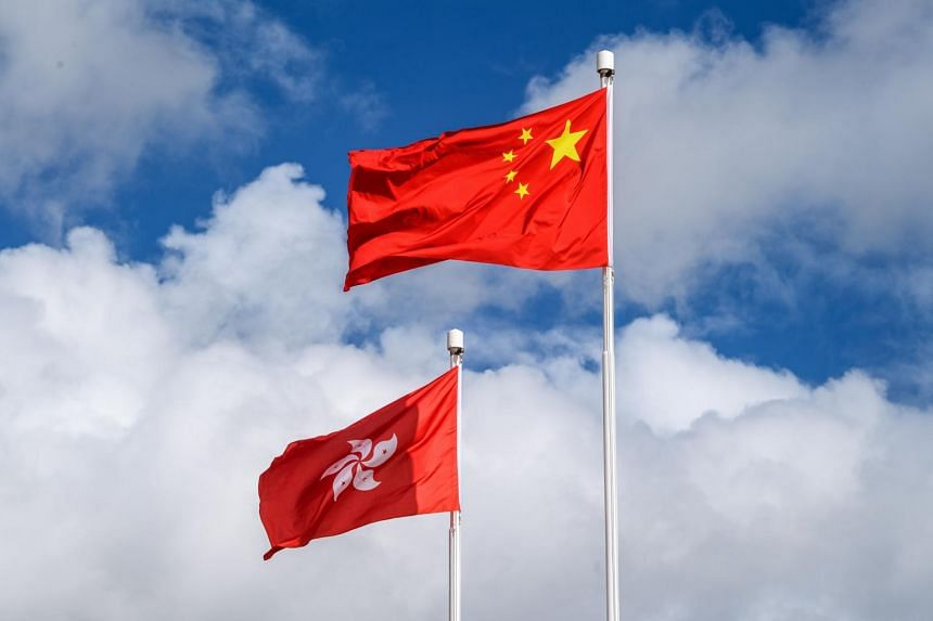 The Chinese and Hong Kong flags are seen hoisted in Hong Kong on July 1, 2020.