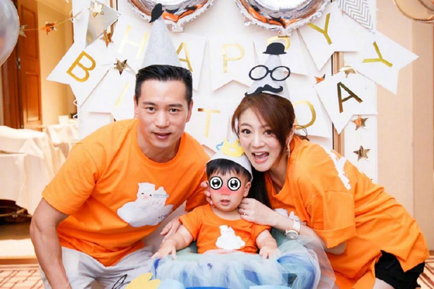 Ady An (right) celebrates the one-year-old birthday of her son with her husband Levo Chan (left).