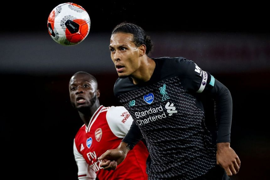 Liverpool's Virgil van Dijk (right) in action during the match.
