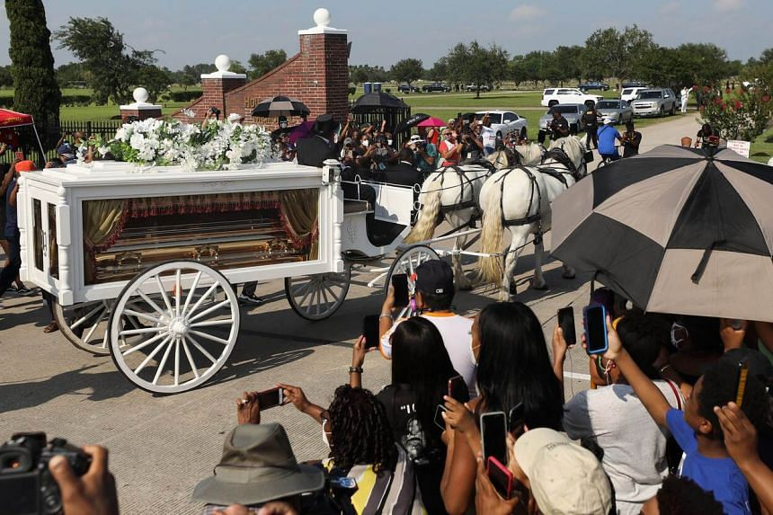 The remains of George Floyd are transported in a funeral procession on June 9, 2020 in Pearland, Texas.