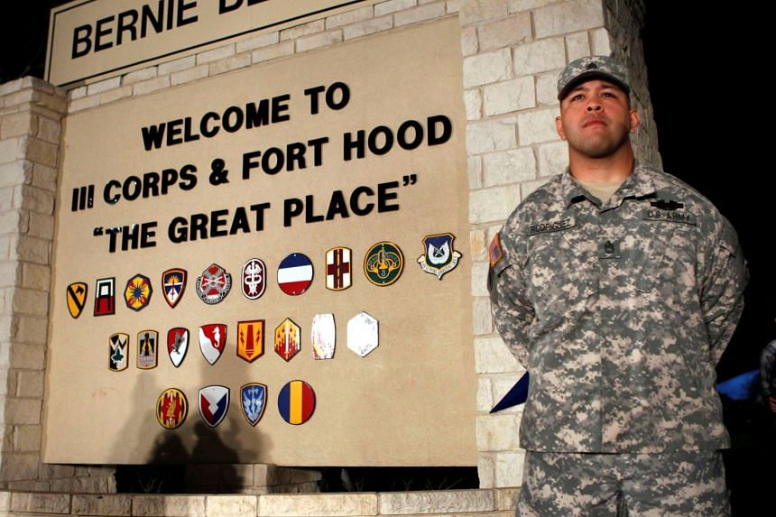 A 2014 photo shows a soldier standing guard at the entrance to Fort Hood Army base in Texas.