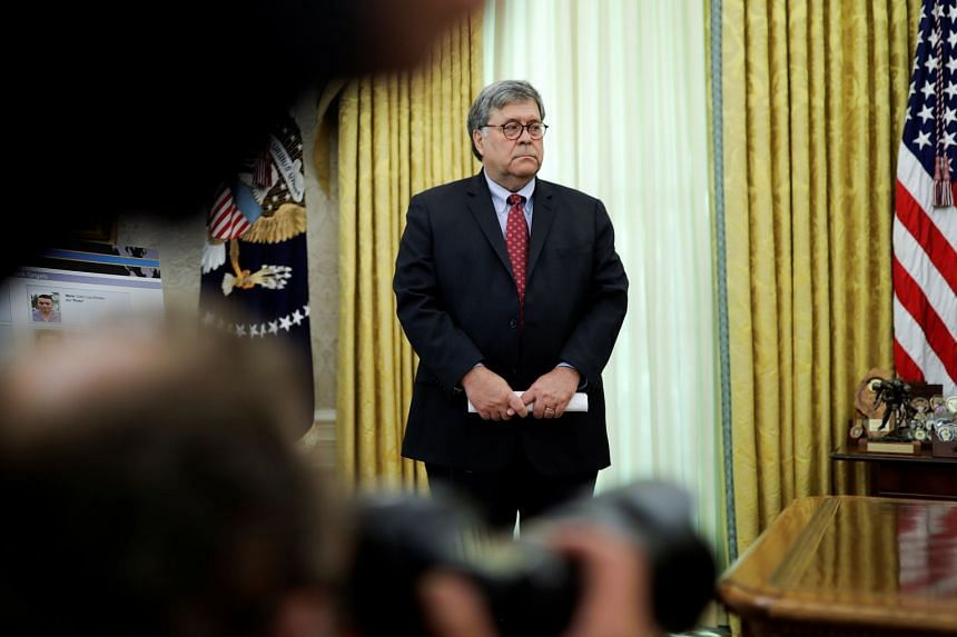 Barr listens as US President Donald Trump speaks at the White House, July 15, 2020.