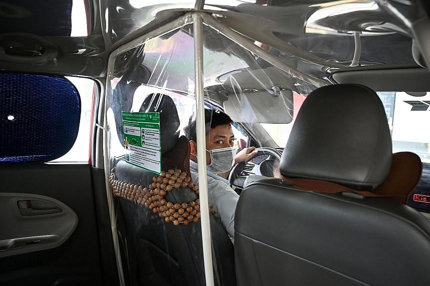 A sign outside a barber shop in Wellington in May. New Zealand, which was ranked 35th on the Global Health Security Index, did well in its Covid-19 response. A taxi driver in Hanoi with a plastic screen to separate him from passengers. Vietnam is amo