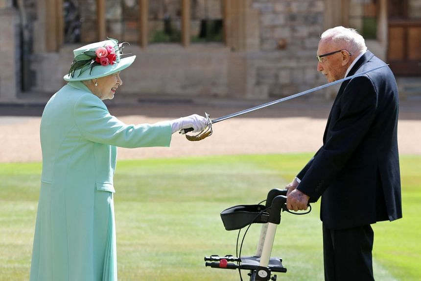 Britain's Queen Elizabeth II uses her father's sword to confer the Honour of Knighthood on 100-year-old World War II veteran Tom Moore.