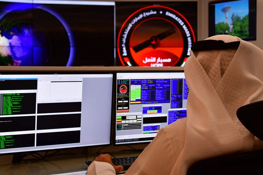 An employee works at the control room of the Mars Mission at the Mohammed Bin Rashid Space Centre in Dubai on July 5, 2020.