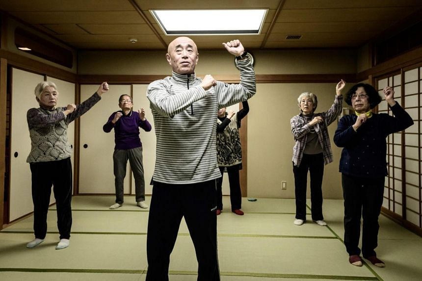 Judo therapist Taisuke Kasuya (centre) leads judo-based exercises at a community centre in Tokyo on Feb 17, 2020.