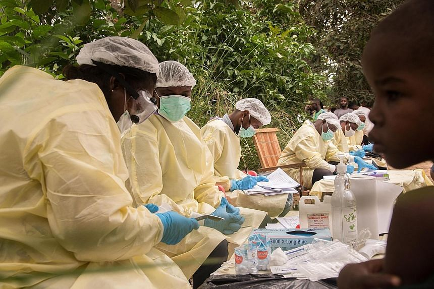 Medical teams preparing to vaccinate locals last week in the Mbandaka area in Congo's Equator province amid the Ebola virus outbreak. The World Health Organisation said 56 cases have been reported in the province, more than the total number of cases