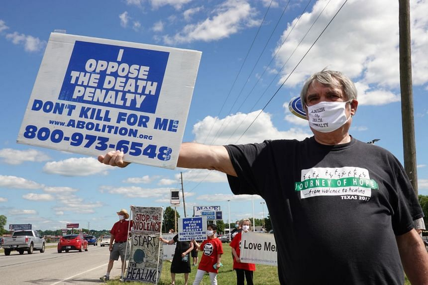 People opposed to the death penalty protest near a US correctional facility in Indiana on July 13, 2020.