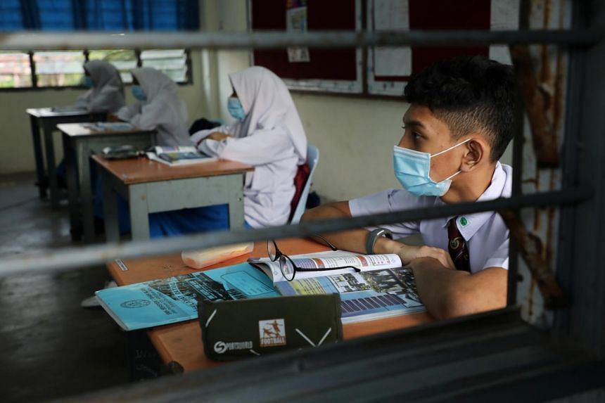 Students wear masks during class at a secondary school in Shah Alam, Malaysia, on June 24, 2020.