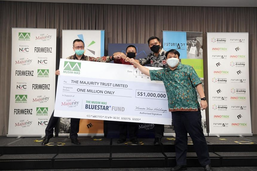 (From left) Chief Financial Officer of Musim Mas Holdings Alvin Lim, Minister for Social and Family Development Desmond Lee, Executive Director of The Majurity Trust Martin Tan and founder of Character and Leadership Academy Delane Lim at the cheque
