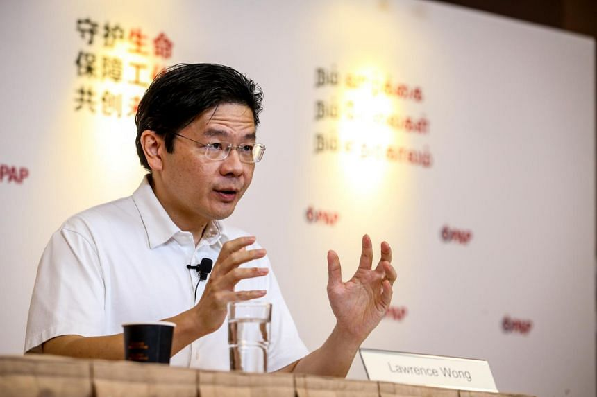 Minister Lawrence Wong speaks to reporters at PAP headquarters on July 18, 2020.