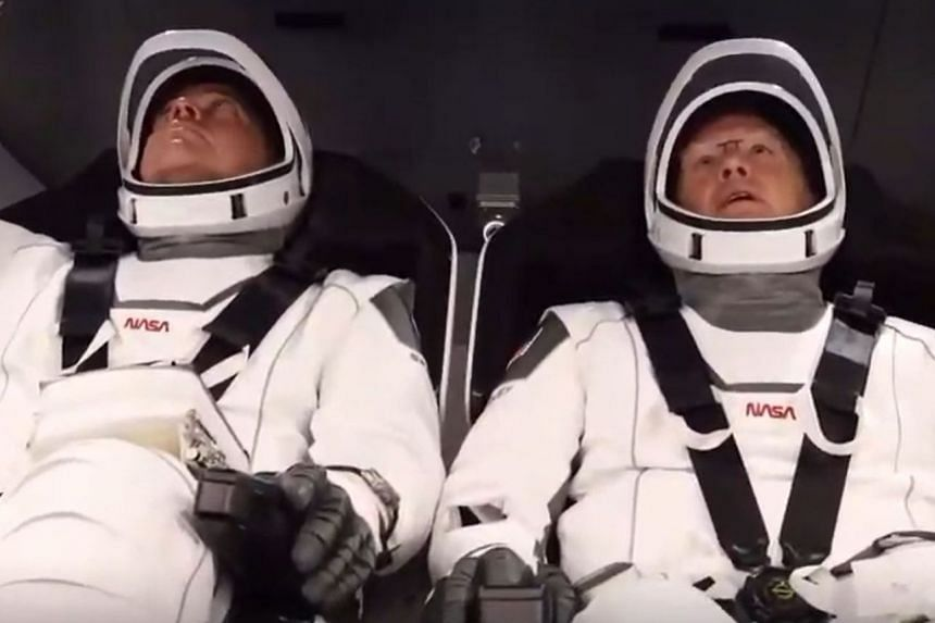 Bob Behnken (left) and Doug Hurley strapped into the SpaceX Crew Dragon capsule on May 30, 2020.