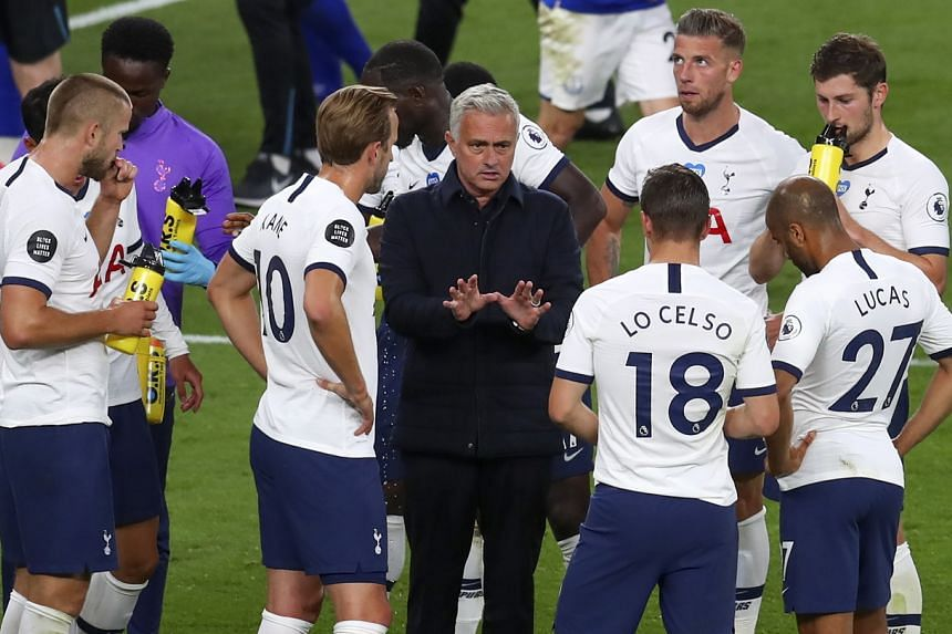 Tottenham Hotspur manager Jose Mourinho (centre) talks to his players during a match in London on July 6, 2020.