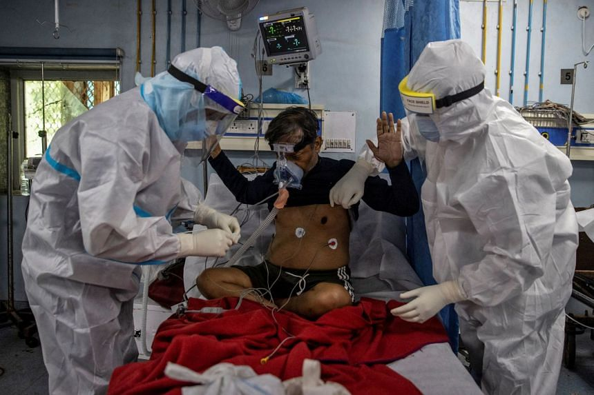 Medical workers tend to a Covid-19 patient at a hospital in New Delhi, India, July 17, 2020.