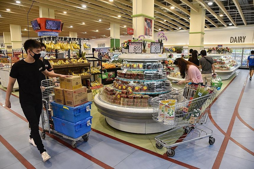 Shoppers at FairPrice Xtra SportHub in Kallang Wave Mall. The importance of food security has been underscored in the ongoing Covid-19 pandemic which has disrupted food supply chains, said Dr Amy Khor, adding that climate change can also impact suppl