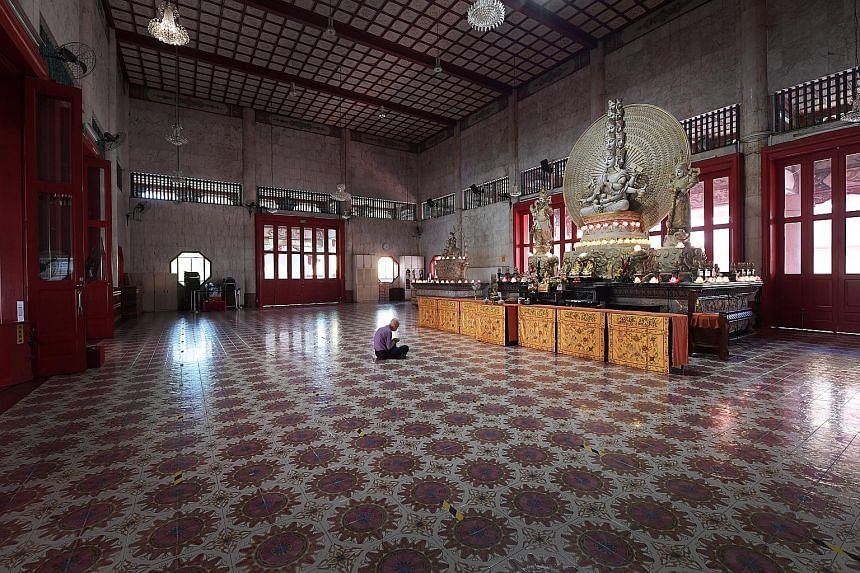 At Kong Meng San Phor Kark See Monastery, Singapore's largest Buddhist temple, worshippers have to book slots via an online system before visiting.