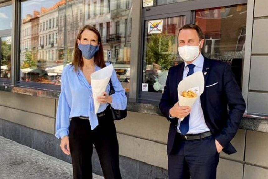 "Belgian Prime Minister Sophie Wilmes tweeted a photograph (above) of herself and Luxembourg Prime Minister Xavier Bettel outside the famous Maison Antoine ""friterie""."