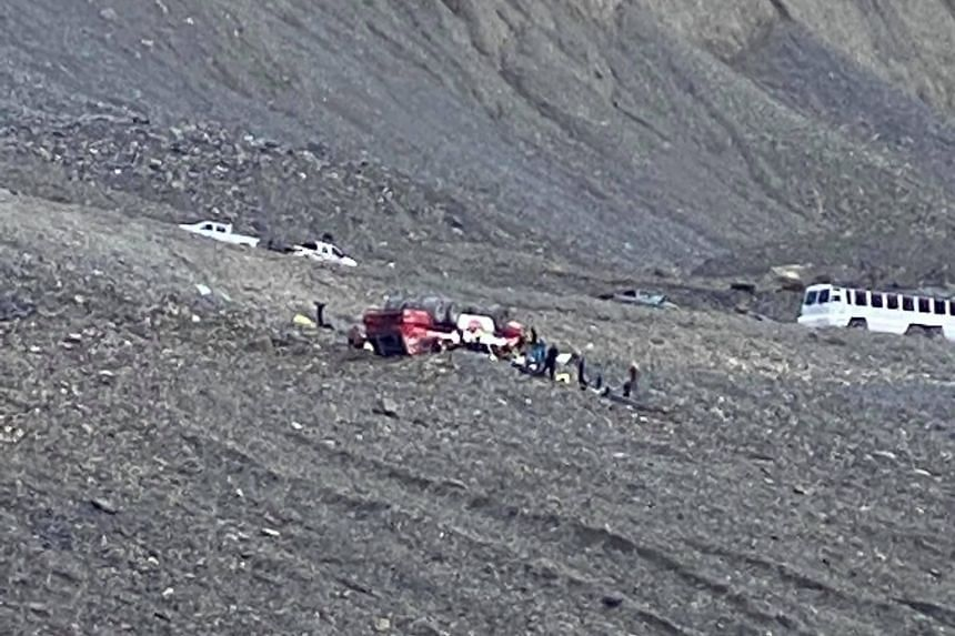 The bus was climbing a rocky, steep road to the Columbia Icefields in Jasper National Park when it plunged down an embankment.
