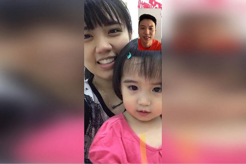 Ms Shermaine Chan in Johor with her daughter, in a video call with her husband, who has to stay here.