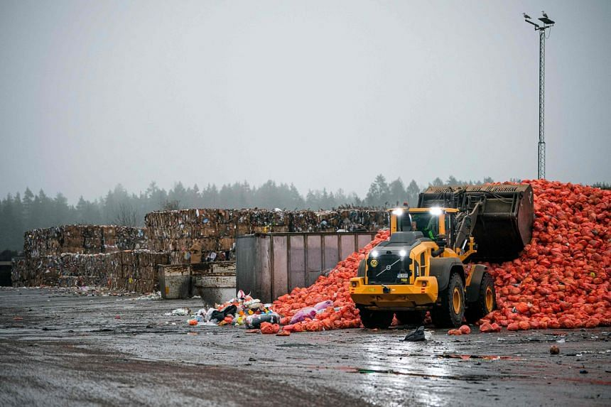 In a photo taken on Nov 15, 2019, orange bags with plastic recycling content are being processed at the recycling centre in Eskilstuna.