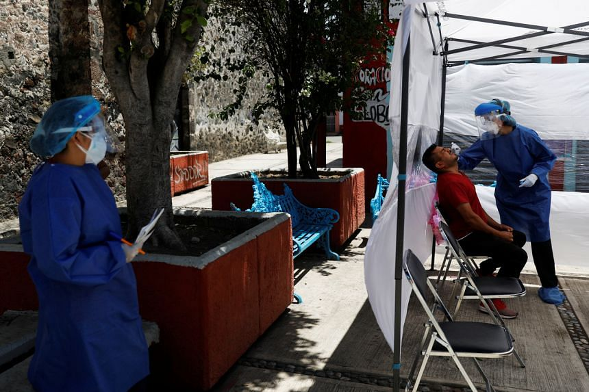 A health worker conducts a coronavirus test in the municipality of Tlahuac, in Mexico, on July 15, 2020.