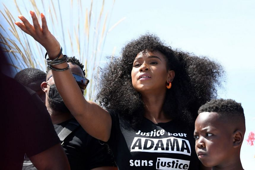 Assa Traore (centre), sister of Adama Traore takes part in a rally outside Paris on July 18, 2020.