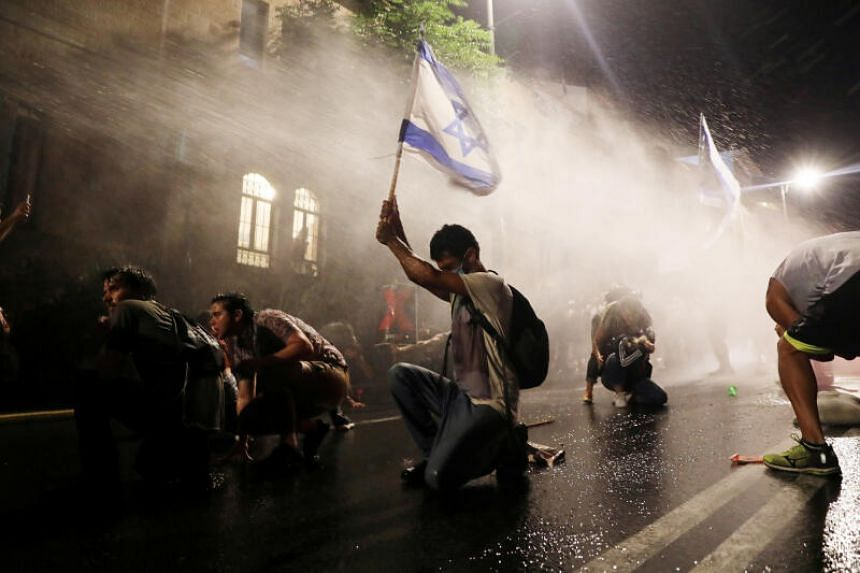 Israeli police using water cannon against protesters demonstrating against PM Benjamin Netanyahu in Jerusalem on July 18, 2020.