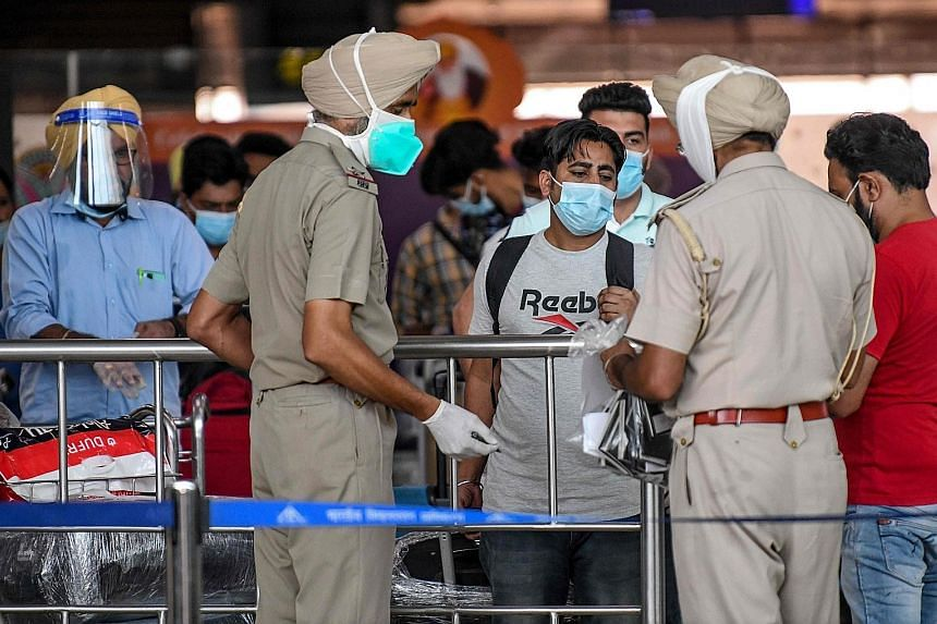 Police in the Indian city of Amritsar checking the details of Indian nationals returning from the UAE on a special flight last week.