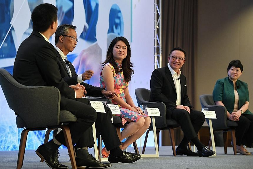The panellists - (from left) SkillsFuture Singapore CEO Ong Tze-Ch'in; Pan Pacific Hotels Group CEO Choe Peng Sum; HRnetGroup executive director Adeline Sim; Ademco Security Group's group managing director Toby Koh; Greenpac CEO Susan Chong - discuss