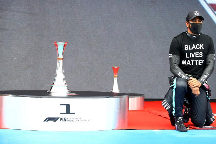 Mercedes' Lewis Hamilton kneels in support of the Black Lives Matter campaign before Hungarian GP race.