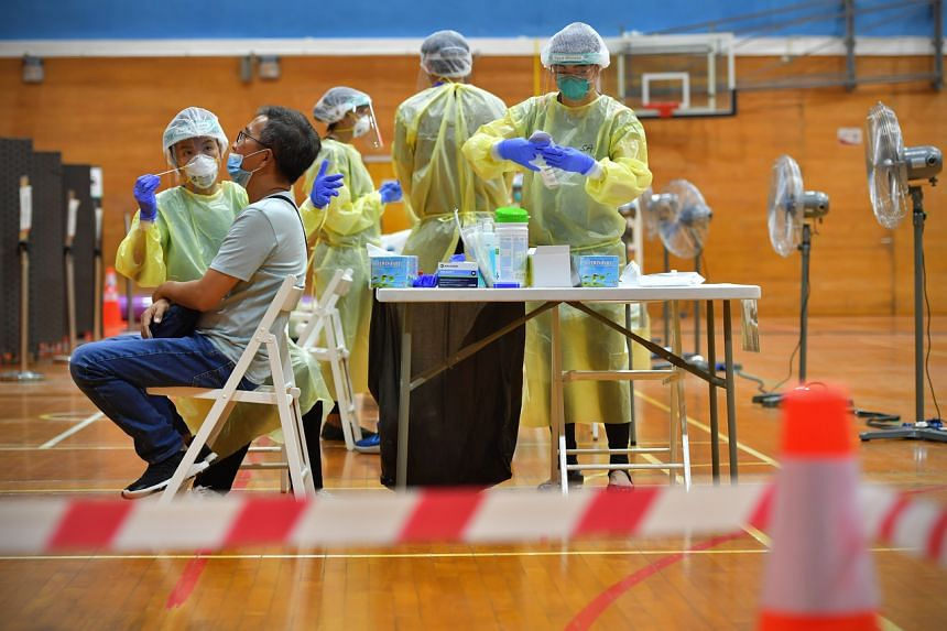 Swab testing for Covid-19 being carried out at the regional screening centre set up at Bukit Gombak Sport Hall on June 9, 2020.