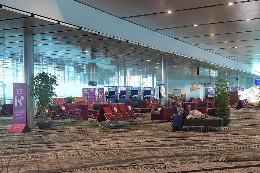"""The transit holding area at Changi Airport Terminal 3 last month. Changi Airport Group said it has handled more than 10,000 transit passenger movements since the gradual reopening to transit flights on June 2, """"though these still remain at very low l"""