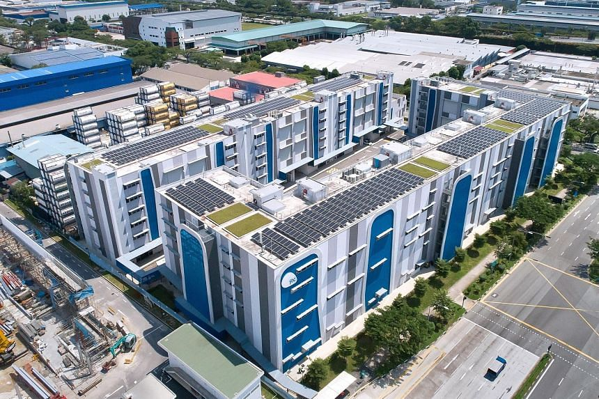 Solar panels on the rooftop of JTC Space @ Gul. JTC Corporation's SolarRoof initiative aims to fast-track solar power adoption on the rooftops of 50 JTC buildings as well as those of JTC's lessees, spanning about 18ha. This is expected to create 15MW
