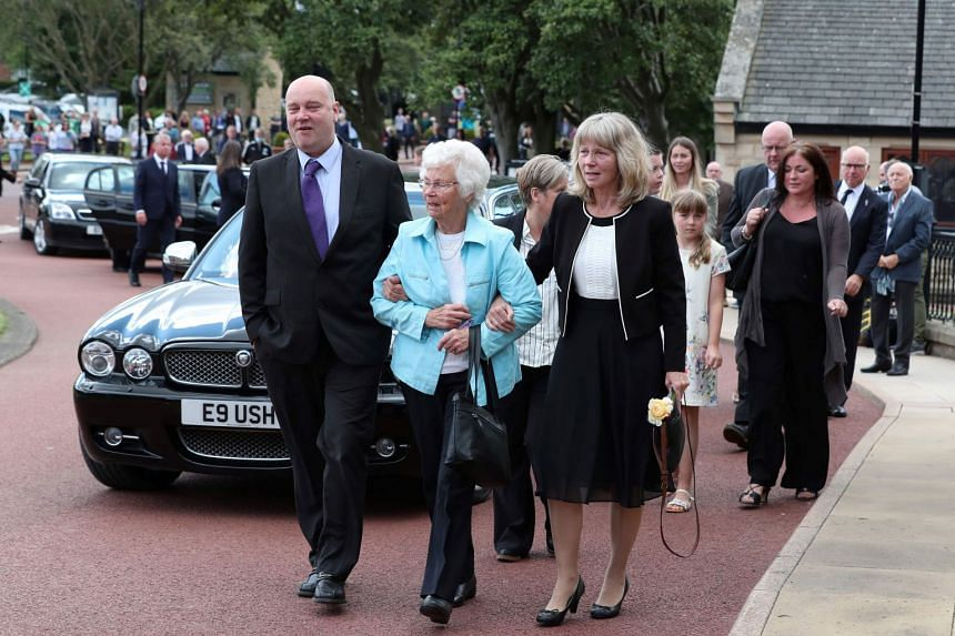 Wife Pat (centre) arrives with the funeral cortege of British football legend Jack Charlton at West Road Crematorium, in Newcastle.