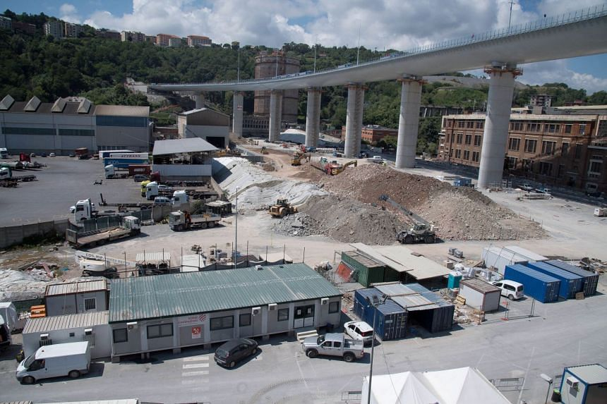 Trucks driving over the new Genoa Bridge for the second day as part of a static test to examine the robustness of the structure.