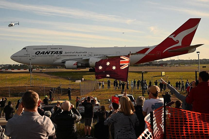 The last Qantas Boeing 747 airliner preparing to take off from Sydney airport for its journey to the Mojave Desert in California yesterday. The downturn in the airline industry following travel restrictions due to the Covid-19 pandemic has forced Qan