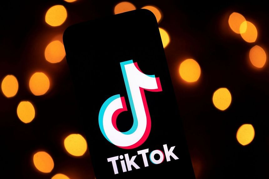 The logo of the social media video sharing app Tiktok is displayed on a tablet screen.