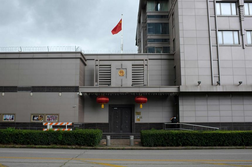 The Chinese flag flies outside of the Chinese consulate in Houston on July 22, 2020.