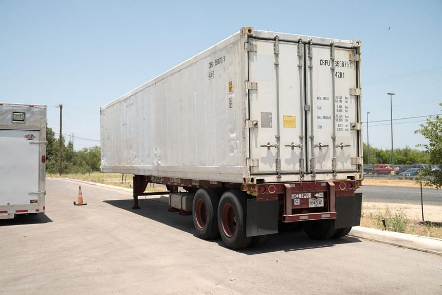 A refrigerated trailer that health authorities acquired to store bodies is seen in Bexar County, Texas, on July 15, 2020.
