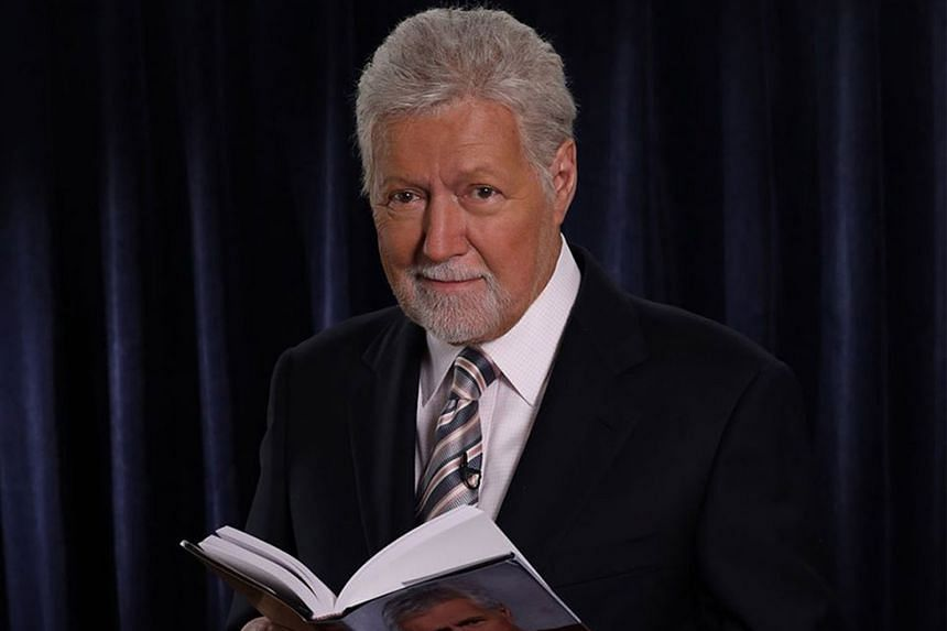 Quiz-show host Alex Trebek (above) with a copy of his new memoir, The Answer Is...: Reflections On My Life.