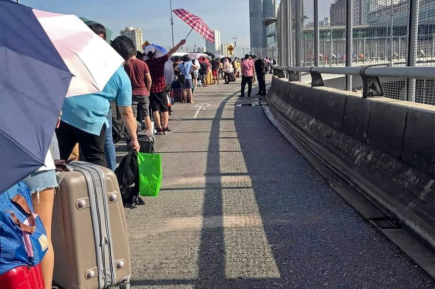 Pictures widely shared on social media sites show people queueing to cross the Causeway to Malaysia on July 23, 2020.