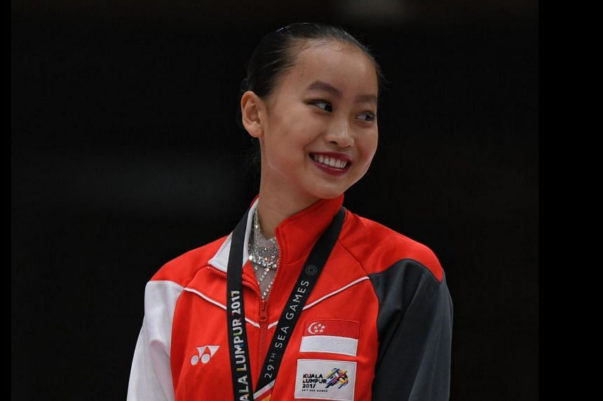 Yu Shuran stands on the podium after the SEA Games women's figure skating competition on Aug 27, 2017.
