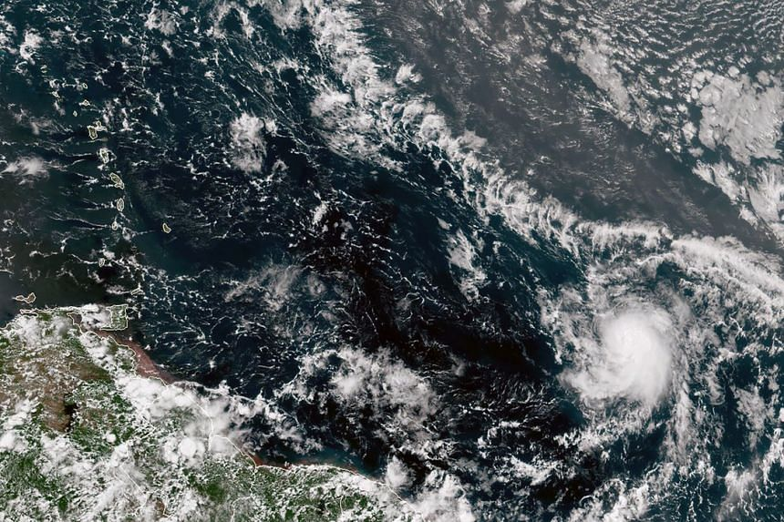 A satellite photo shows tropical storm Gonzalo (bottom right) churning towards the Caribbean on July 22, 2020.
