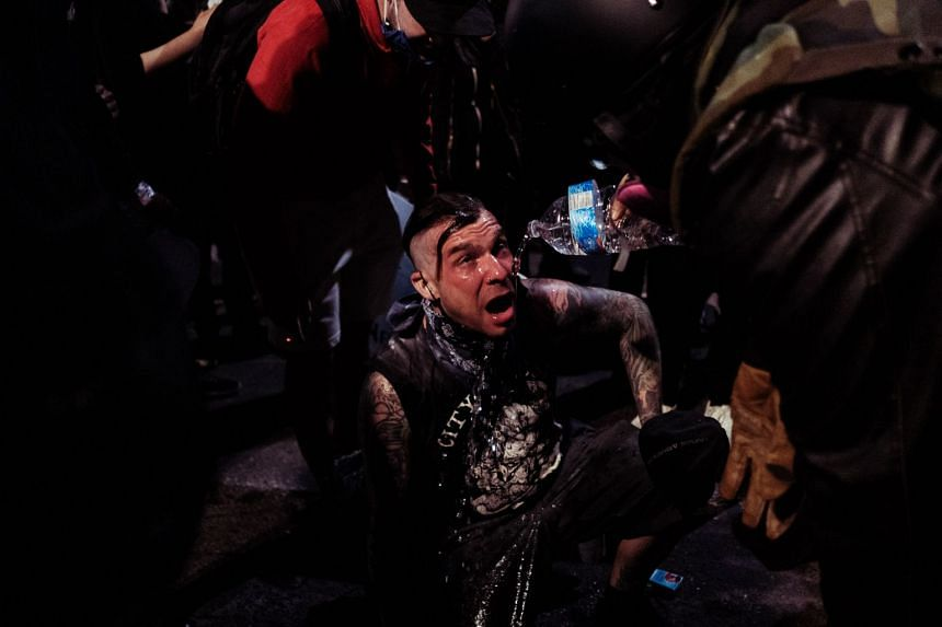 A protester suffering from the effects of tear gas on July 22, 2020, in Portland, Oregon.