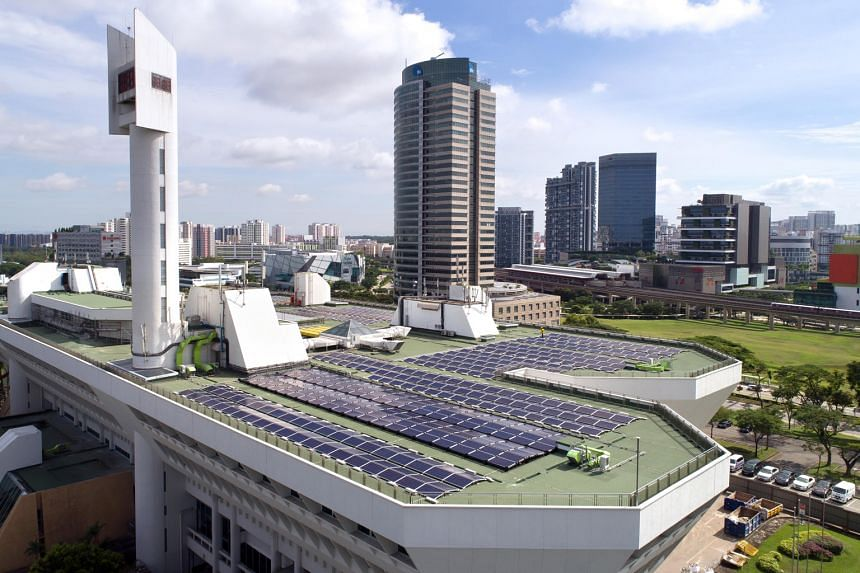 Solar panels on JTC's Jurong Town Hall rooftop. Singapore is on track to reach its solar energy generation target of 350 megawatt-peak by the end of this year, according to the Energy Market Authority. PHOTO: JTC