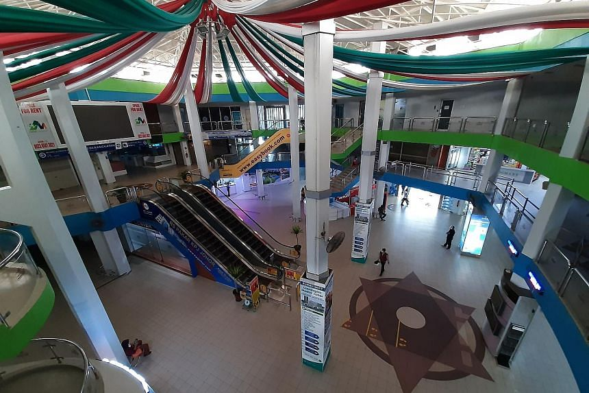 The usually bustling Batam Centre Ferry Terminal has been turned into a ghost port as the coronavirus pandemic keeps stores shuttered.