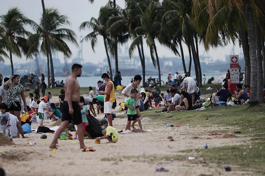 Right: Restaurants and bars in places such as Holland Village will continue to be closely monitored for breaches. Below: Beaches like the one at East Coast Park will see capacity limits implemented following crowding at the start of the school holida