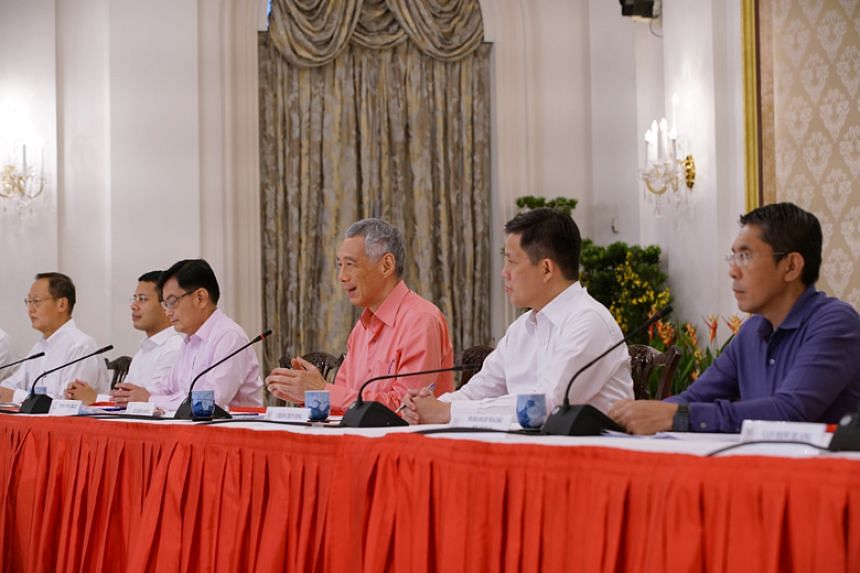 Prime Minister Lee Hsien Loong unveiling the new Cabinet line-up during a press conference at the Istana on July 25, 2020.